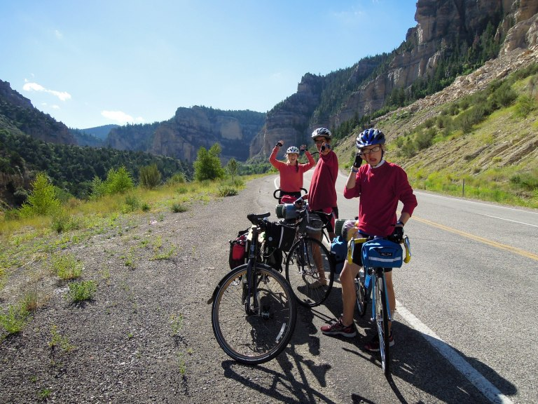 Natalie, Niels, and Finn on Day 6 of a 6 day bike tour; Cedar Canyon headed down to Cedar City, UT.
