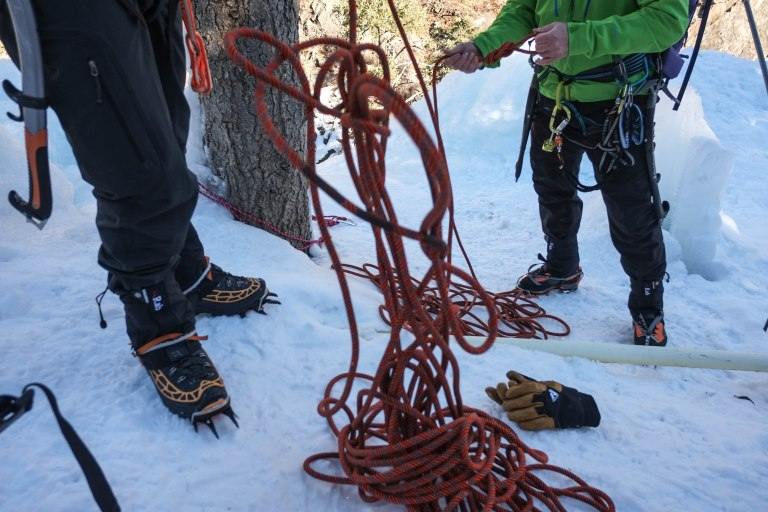 Untangling a rope to set up another anchor.