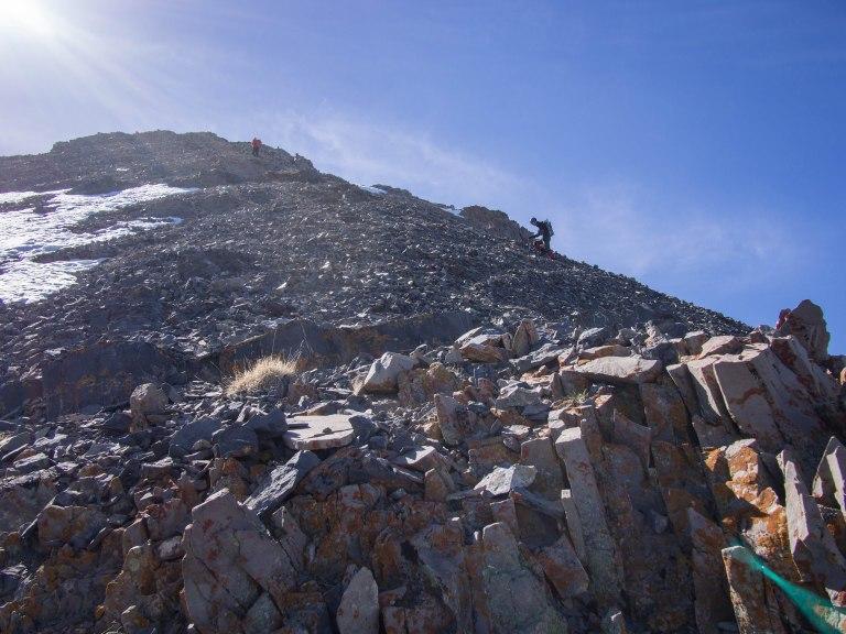 Climbing the rocky ridgeline.