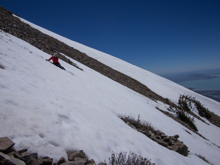 Kai beginning the glissade near the top of the Timp summit ridge.