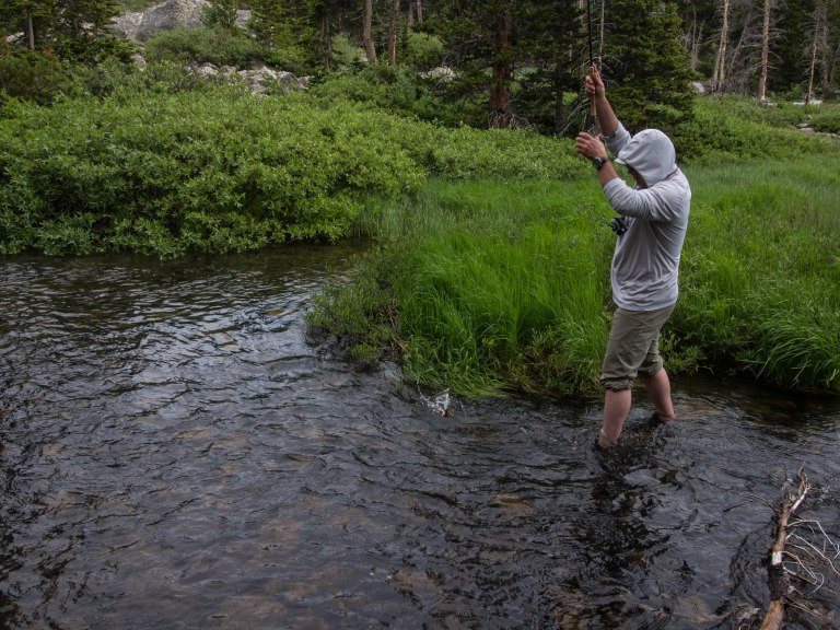 Fishing the creek next to camp. The first two casts netted two fish.