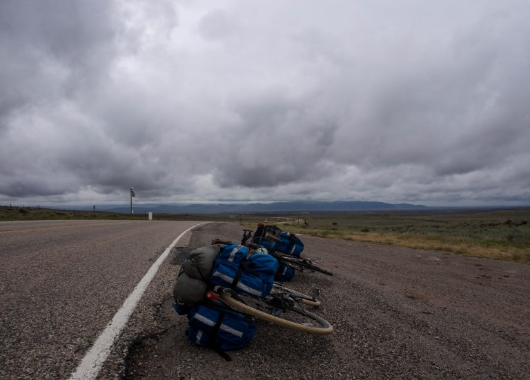 Bikes, road, sagebrush, sky.
