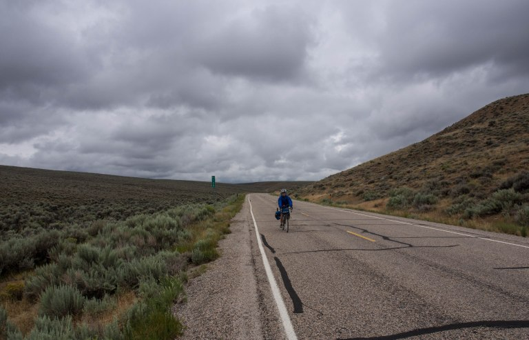Lars riding through the sagebrush.