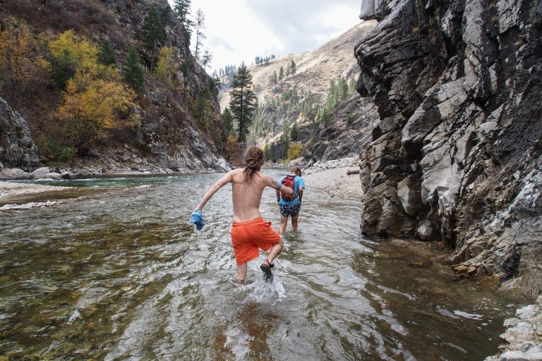 Wading through the very cold South Fork of the Payette River.