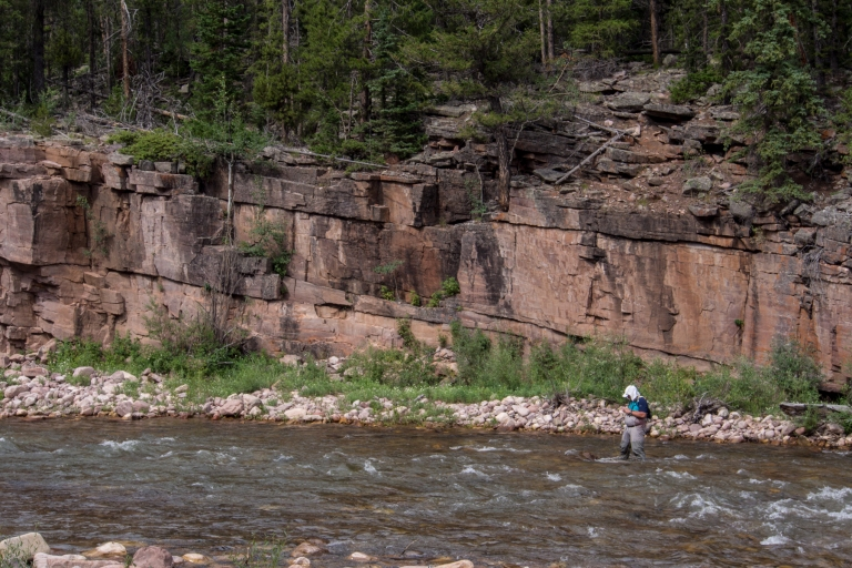 Kai wading in the Uinta River just upriver from the bridge.