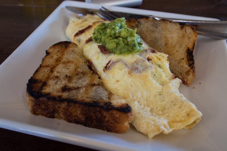 Chorizo and avocado omelet with toast.